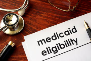 medicaid eligibility written on a document, with a stethoscope